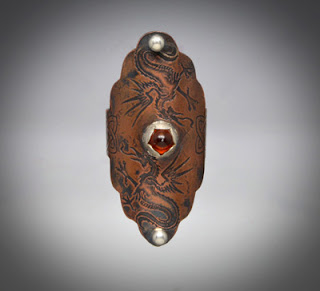 http://brackendesigns.com/product/double-dragon-copper-ring-amber-and-silver-accents