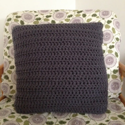 crocheted pillow cover