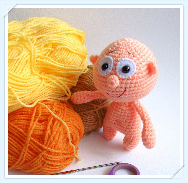 crocheted amigurumi-soft-toy-boy-doll-pink yarn crochet'amigurumi-soft-toy-boy-