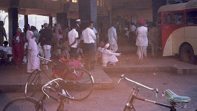 Bicycles and people in bus station