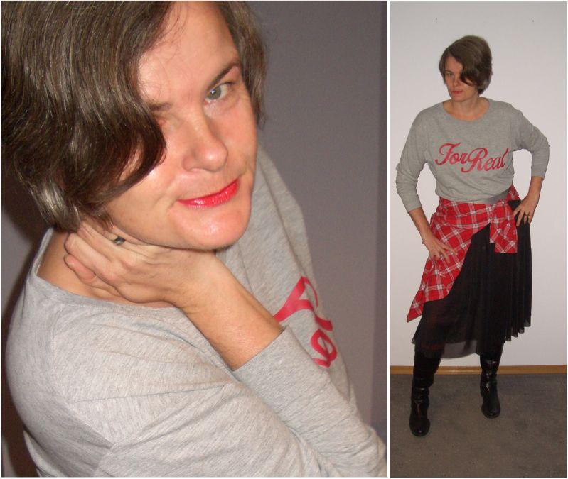Tüllrock zu Karohemd, Sweatshirt und derben Stiefeln kombiniert.