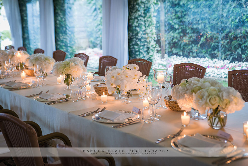Imperial wedding table with vases of white flowers and candles