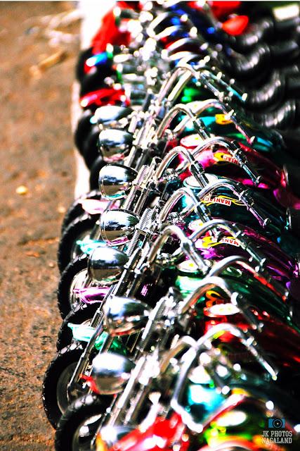 A street vendor with Harley Davidson bike toys.