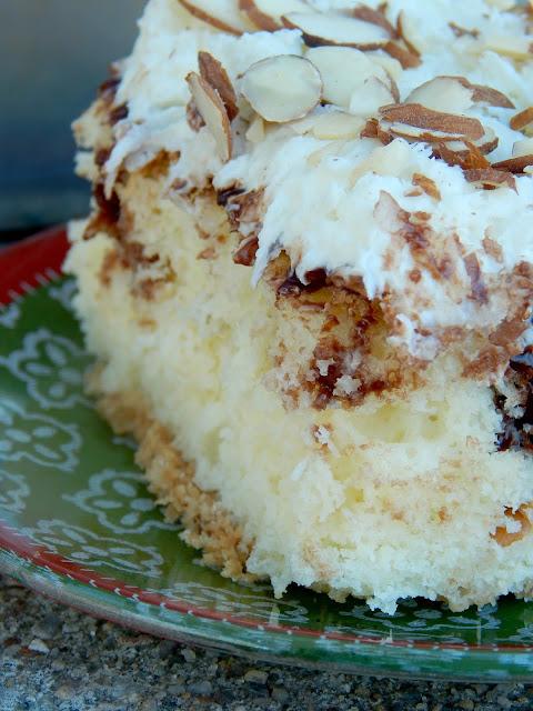 almond joy poke cake {sweetandsavoryfood.com}
