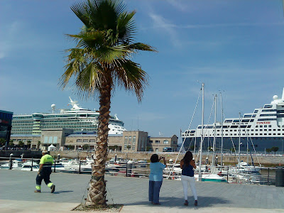 "The cruise ships ""Independence of the Seas"" (left) and ""Queen Mary 2"" (right) doocked in the port of Vigo"