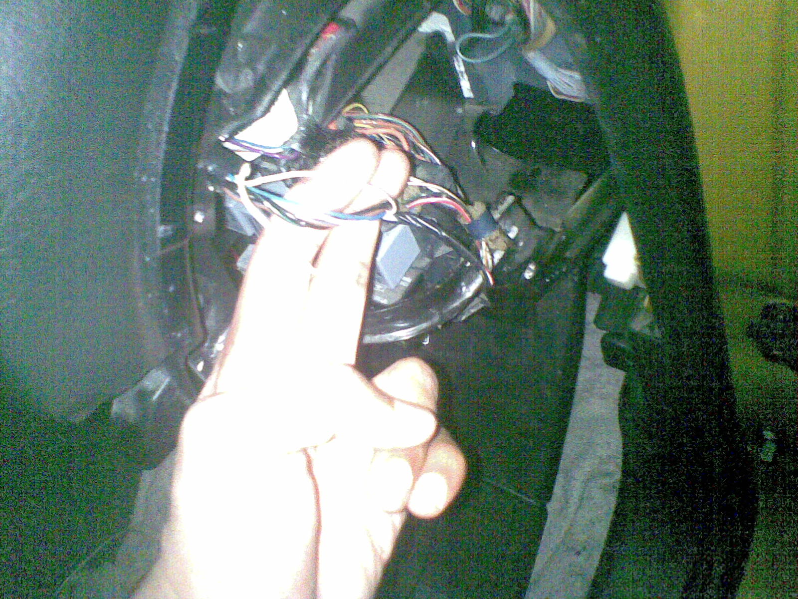 The wiring is all behind the headlight switch see further down the page for  color code