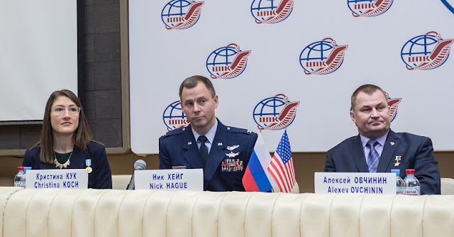 At the Gagarin Cosmonaut Training Center in Star City, Russia, Expedition 59 crew members Christina Koch of NASA (left), Nick Hague of NASA (center) and Alexey Ovchinin of Roscosmos (right) listen to reporters' questions Feb. 21 during a pre-launch news conference. They will launch March 14, U.S. time, on the Soyuz MS-12 spacecraft from the Baikonur Cosmodrome in Kazakhstan for a six-and-a-half month mission on the International Space Station. Credit: Andrey Shelepin/Gagarin Cosmonaut Training Center