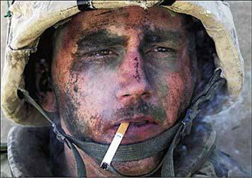 WW2 battle weary soldier with cigarette in his mouth