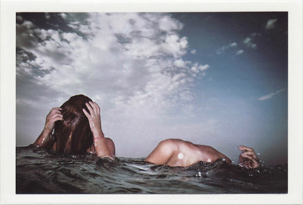 dirty photos - on the island of - photo of two girls inside the sea