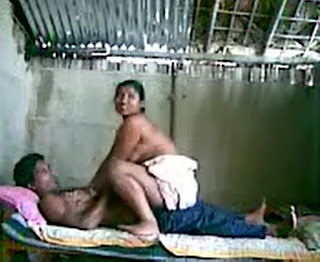 in this image a village Aunty riding on her boyfriend's dick