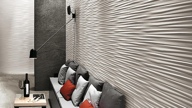 Tile design on wall with multi-faceted reliefs surfaces