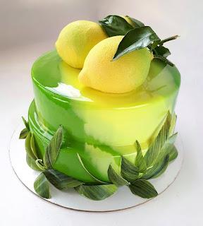 K'Mich Weddings - wedding planning - wedding cake ideas - lemon topper on yellow mirror glaze cake - instagram - on the day wedding planner