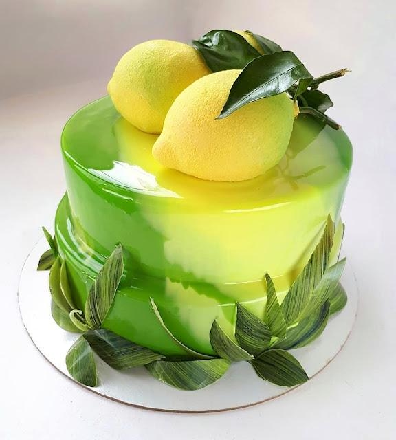 K'Mich Weddings - wedding planning - wedding cake ideas - lemon topper on yellow mirror glaze cake - instagram