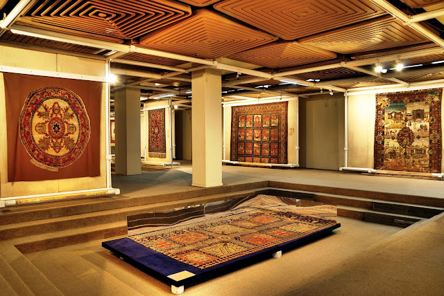 The carpets of the carpet museum installed on the walls.
