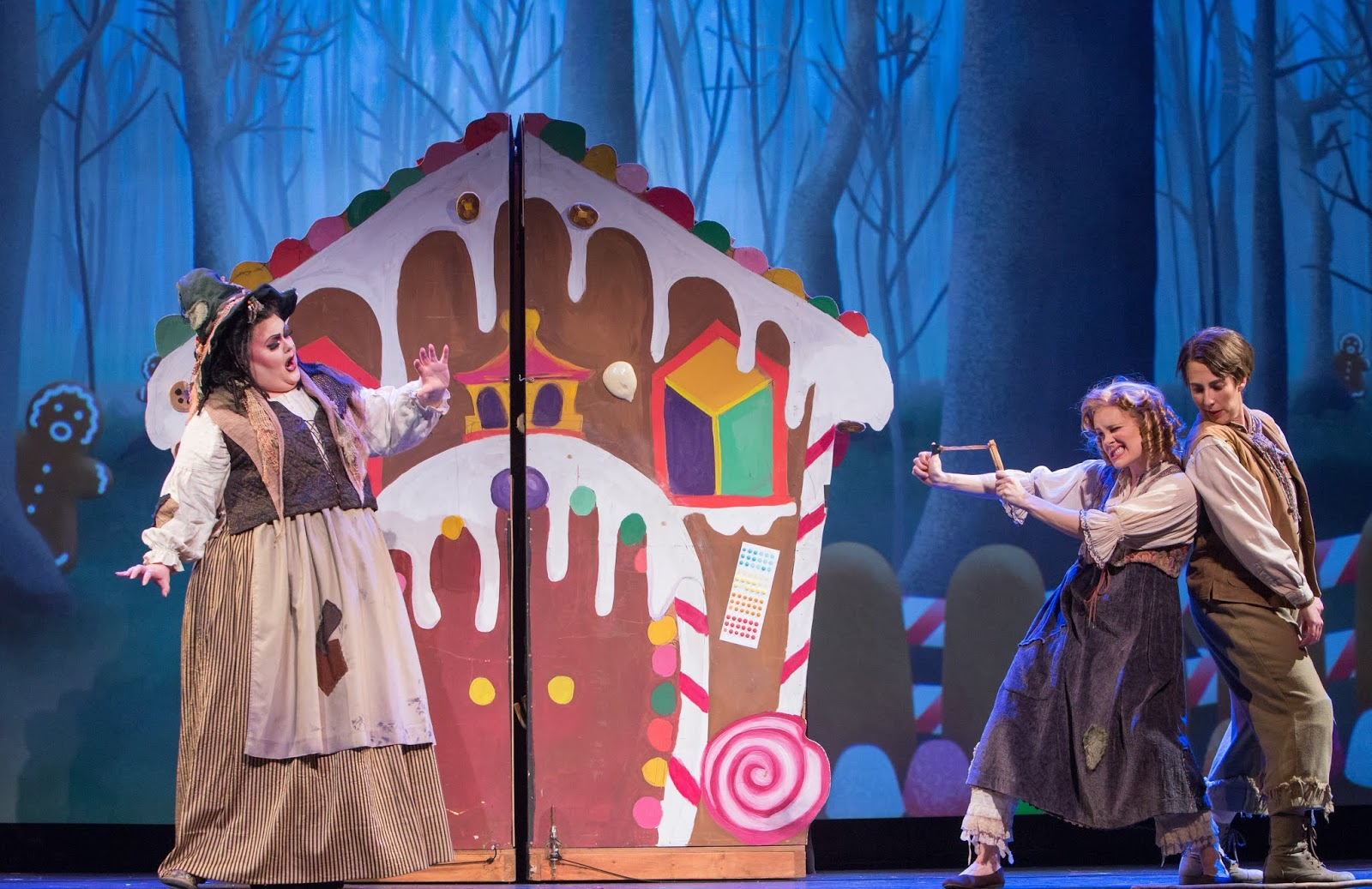 IN PERFORMANCE: (from left to right) mezzo-soprano GRETCHEN KRUPP as Die Knusperhexe, soprano JOANN MARTINSON DAVIS as Gretel, and mezzo-soprano STEPHANIE FOLEY DAVIS as Hänsel in Greensboro Opera's March 2019 production of Engelbert Humperdinck's HÄNSEL UND GRETEL [Photograph © by VanderVeen Photographers]