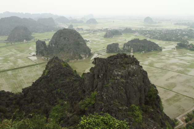Misty limestone and paddy view from Hang Mua, Ninh Binh, Vietnam
