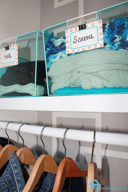 closet makeover with baskets on shelf and design on wall