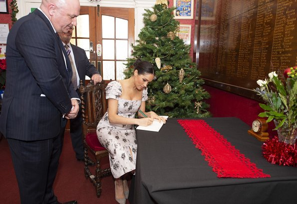 Meghan Markle wore Soia & Kyo Adelaida Ash coat and Brock Collection Odilia floral-print dress, Birks Petale gold and diamond earrings