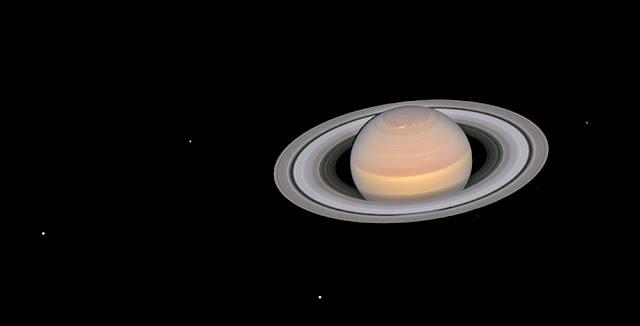 Saturn and its moons at opposition. Credit: NASA, ESA, A. Simon (GSFC) and the OPAL Team, and J. DePasquale (STScI); CC BY 4.0