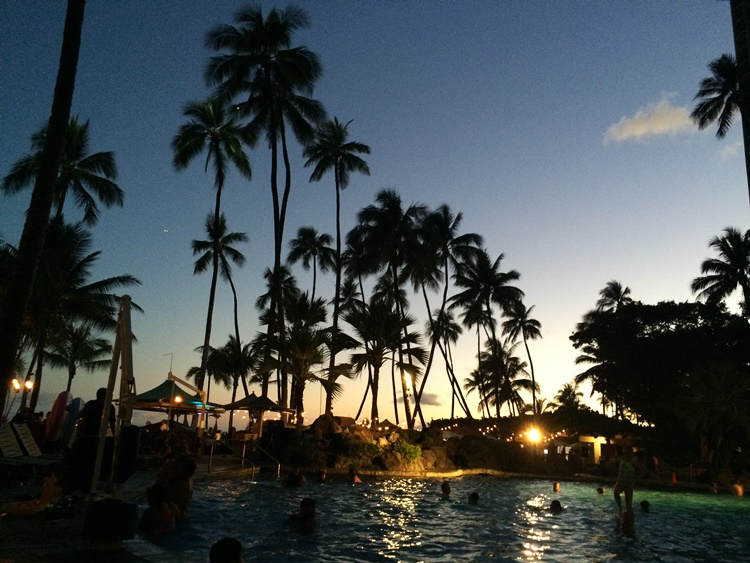 Hawaii - a beautiful palmtreed sunset poolside cliche come true