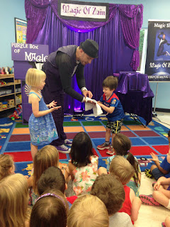 Zain performs magic for audience of kids parties entertainment in northern virginia schools.