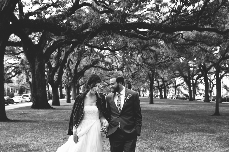 the bride and groom under the mossy trees of Savannah