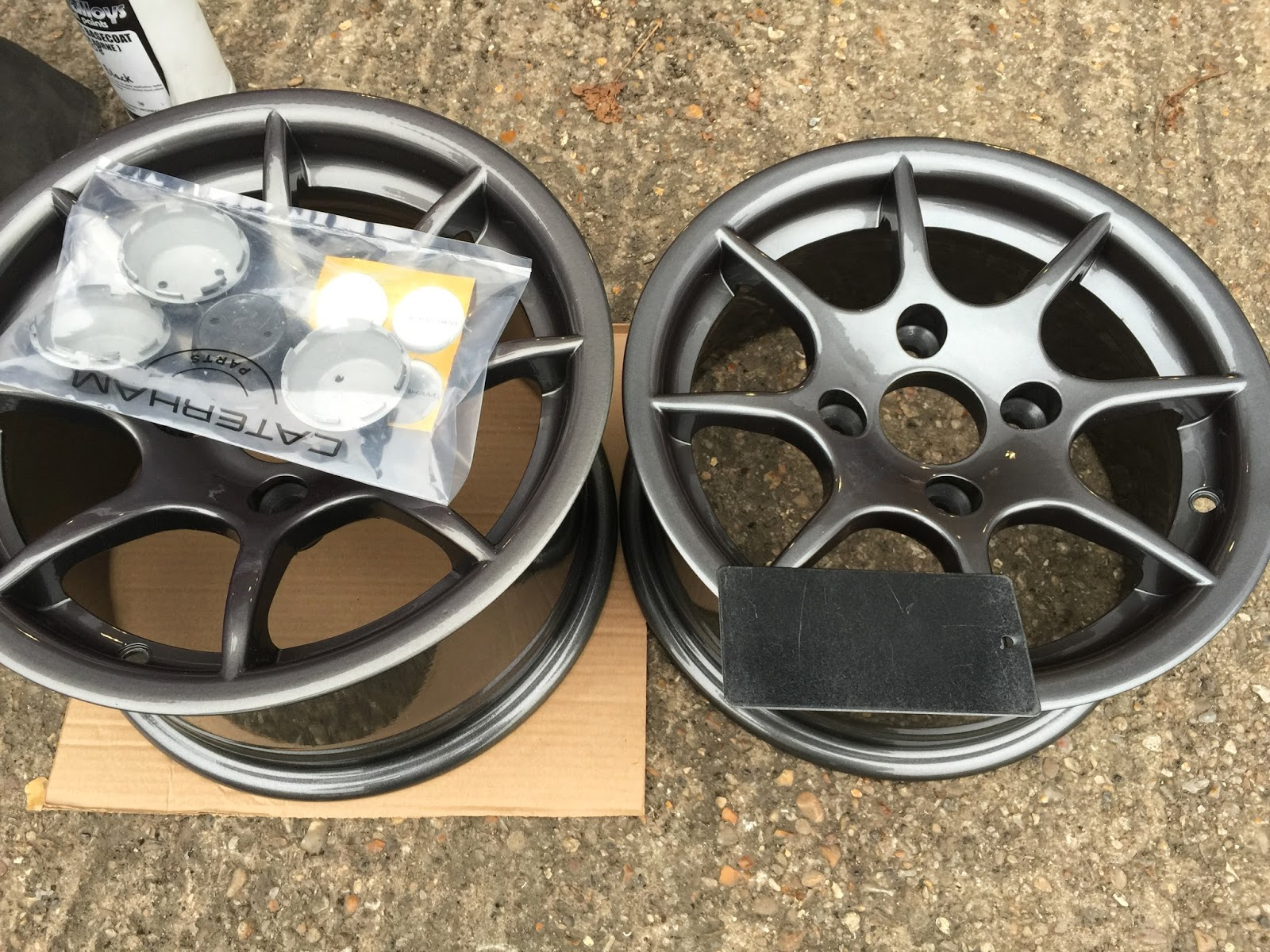 Anthracite Caterham R500 8 spoke alloy wheels with new colour swatch offered up against them.
