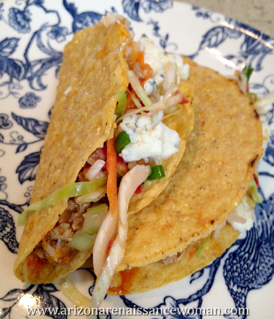 Buffalo Turkey Tacos with Cabbage, Carrot, and Celery Slaw and Gorgonzola