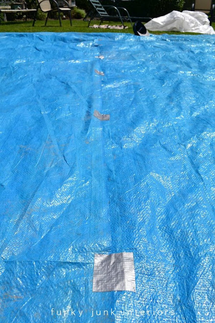 Repair any tarp tears or holes before placing an inflatable above ground pool on top.