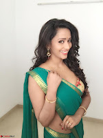 Sanjana Singh Looks Super cute in Green Saree Sleeveless Choli 6.JPG