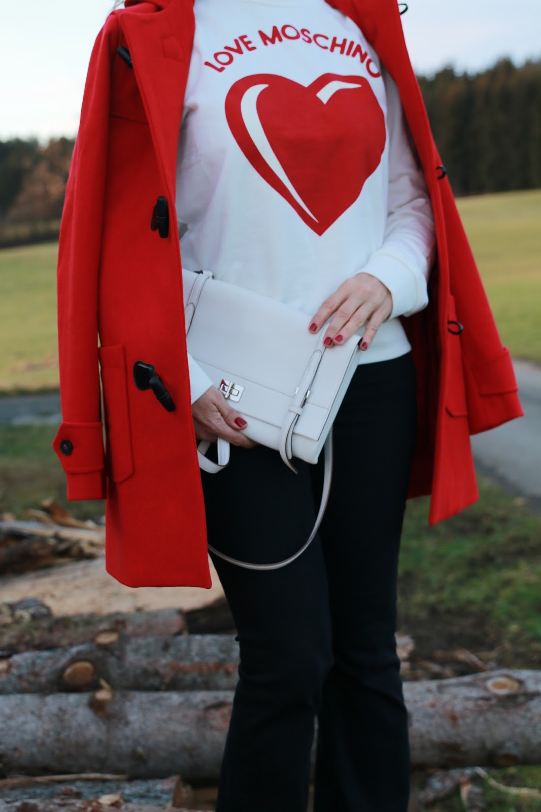 Outfit red duffle coat, white Prada bag, black flared pants, white Moschino heart sweater, beige suede boots fringes