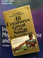 All Creatures Great and Small, by James Herriot, superimposed on Intermediate Physics for Medicine and Biology.