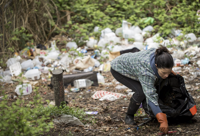 As trash piles up around homeless tent camps, Seattle struggles to keep up