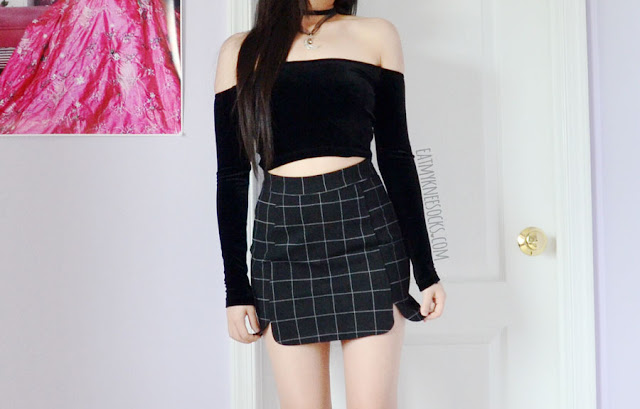 An all-black outfit featuring the black grid bodycon Brandy Melville Raquel skirt dupe from Zaful, paired with an American Apparel off-shoulder black velvet crop top, choker necklaces, and platform booties.