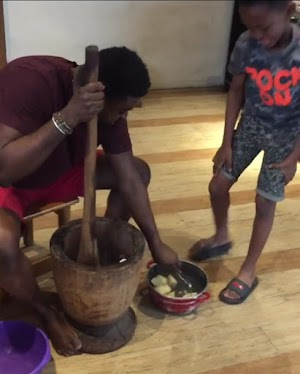 """""""I can only thank Maami for teaching me to be useful in the kitchen.'- Actor Kunle Afolayan Pounding Yam With His Son"""