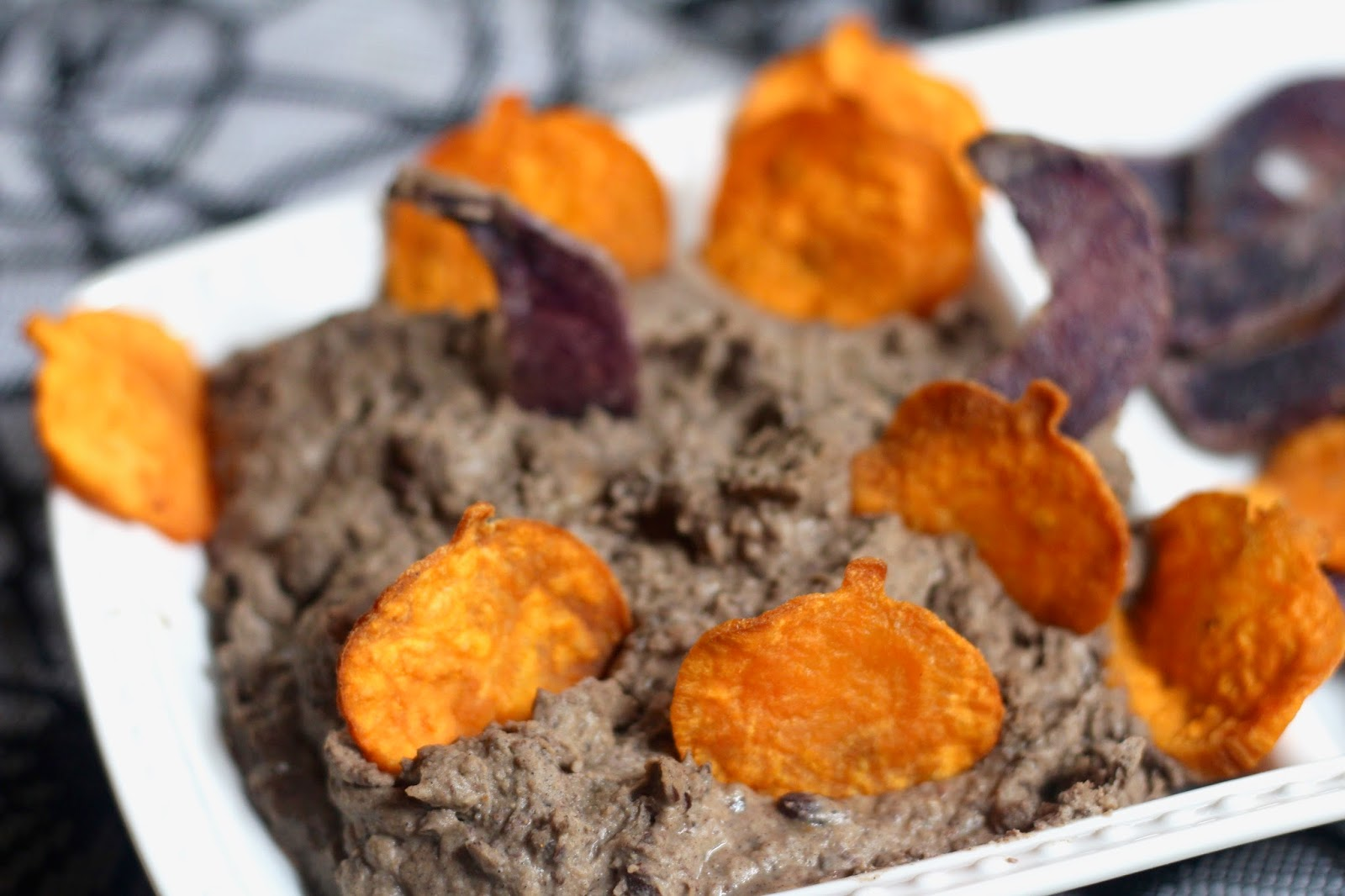of course i couldnt just stop at creating the dip leftover purple and sweet potatoes were sliced use a mandolin for evenness shaped with cookies