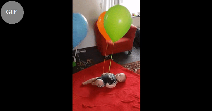 Baby overwhelmed with joy after he realizes he's in control of the balloons