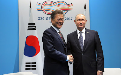 Vladimir Putin with President of South Korea Moon Jae-in.
