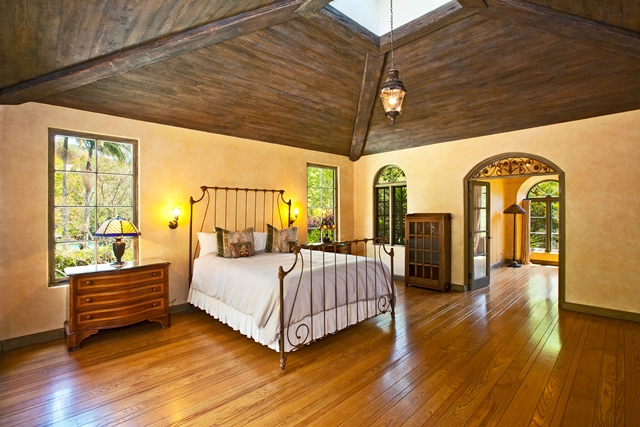 Bedroom of Mel Gibson's house with wooden ceiling and floor