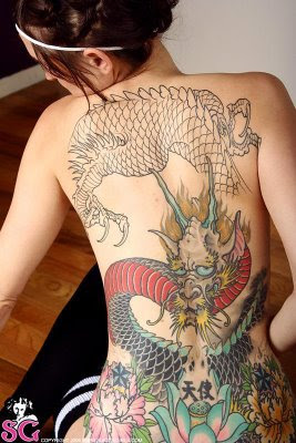 Have sexy girls with dragon tattoos