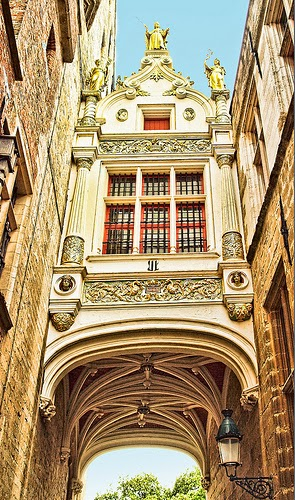 10 Best Places to Holiday in Belgium (100+ Photos) | The beautiful archway over Blinde Ezelstraat (Blind Donkey Street) in Bruges