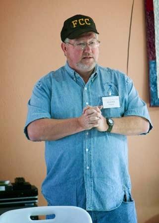 Glenn giving his talk in an FCC hat