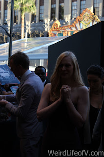 Deborah Ann Woll looks sad that she can't stop to sign autographs