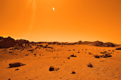 Orange barren type landscape and sky