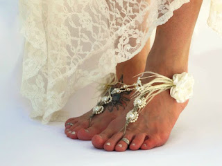 http://www.mojosfreespirit.com/collections/wedding-sandals/products/wedding-barefoot-sandals-ivory-ostrich-feather-detail