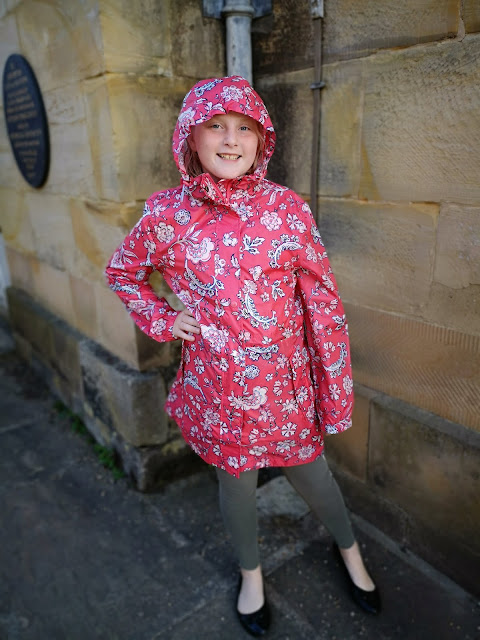 child modelling joules raincoat