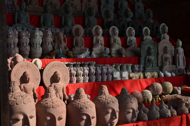 Statues of Buddha on sale, Sarnath