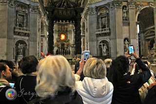 Tourists with their Cell Phones at St Peter's Basilica