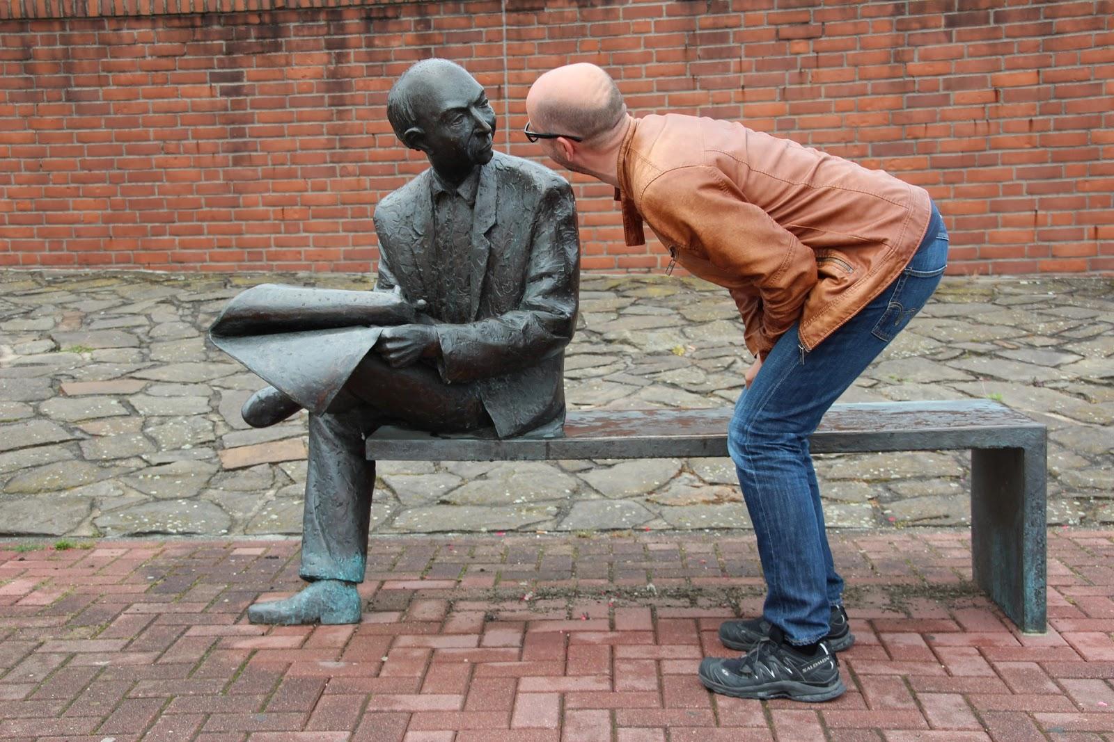 Man looking at statue
