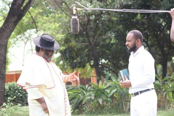 index BTS photo of Pete Edochie & his son, Yul on the set of a movie